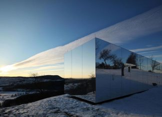 Delugan Meissl Associated Architects design Casa Invisibile, a flexible prefabricated wood structure home