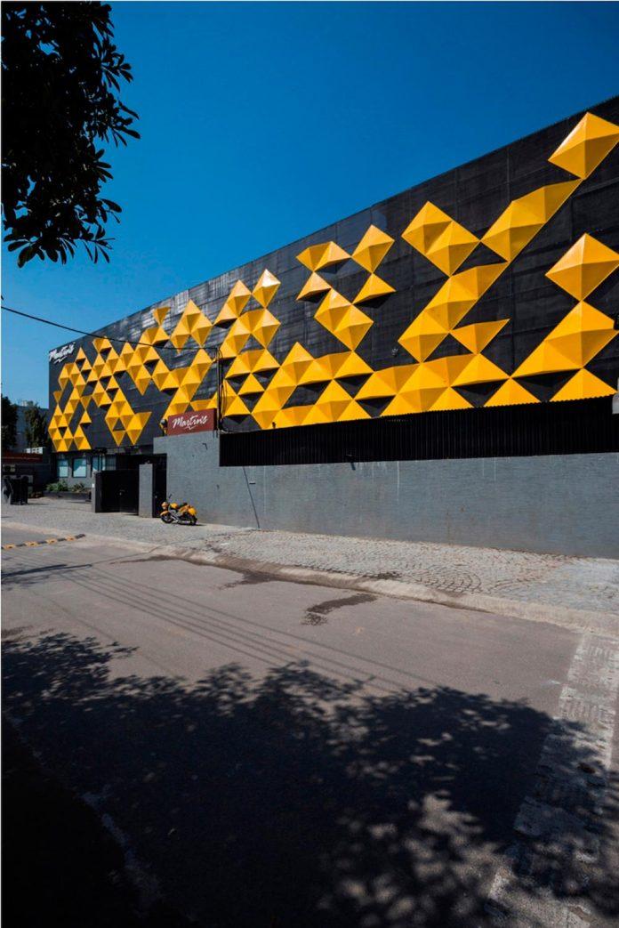 martins-dazzling-yellow-panels-facade-furniture-factory-designed-studio-ardete-02