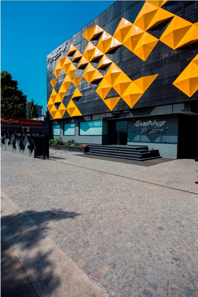 martins-dazzling-yellow-panels-facade-furniture-factory-designed-studio-ardete-03