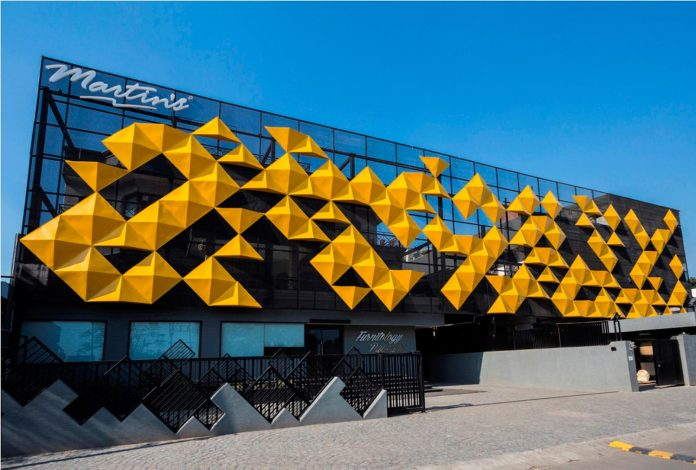 martins-dazzling-yellow-panels-facade-furniture-factory-designed-studio-ardete-04