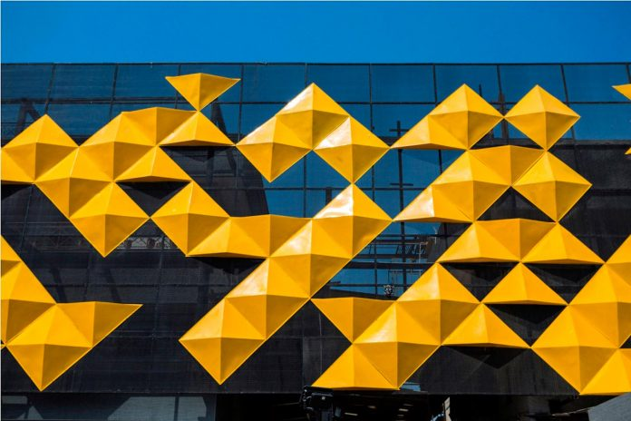 martins-dazzling-yellow-panels-facade-furniture-factory-designed-studio-ardete-05