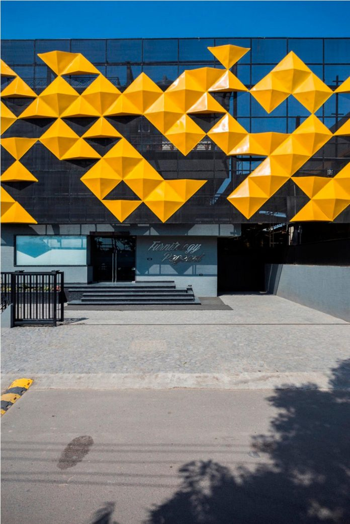 martins-dazzling-yellow-panels-facade-furniture-factory-designed-studio-ardete-06