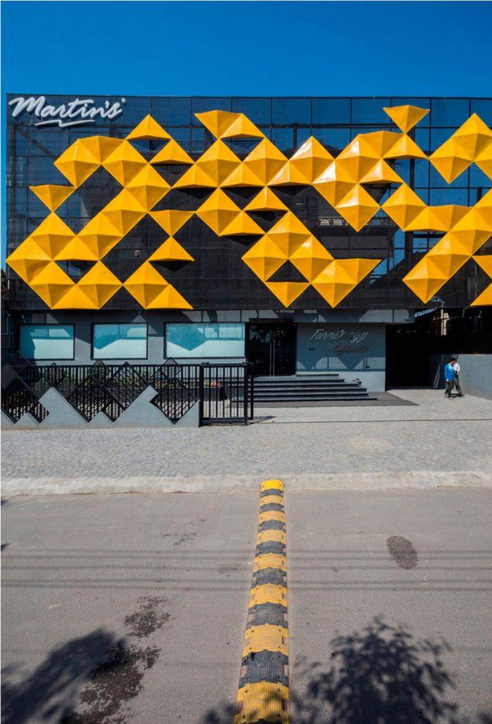 martins-dazzling-yellow-panels-facade-furniture-factory-designed-studio-ardete-07