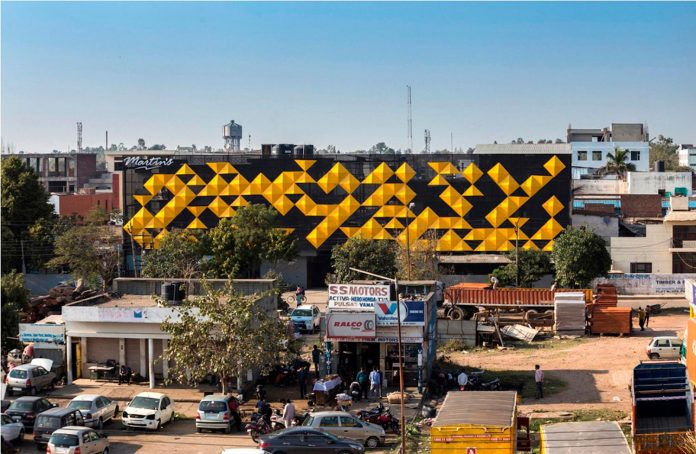 martins-dazzling-yellow-panels-facade-furniture-factory-designed-studio-ardete-08