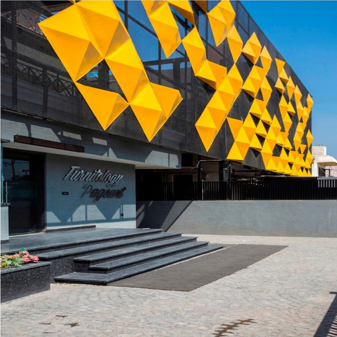 martins-dazzling-yellow-panels-facade-furniture-factory-designed-studio-ardete-09