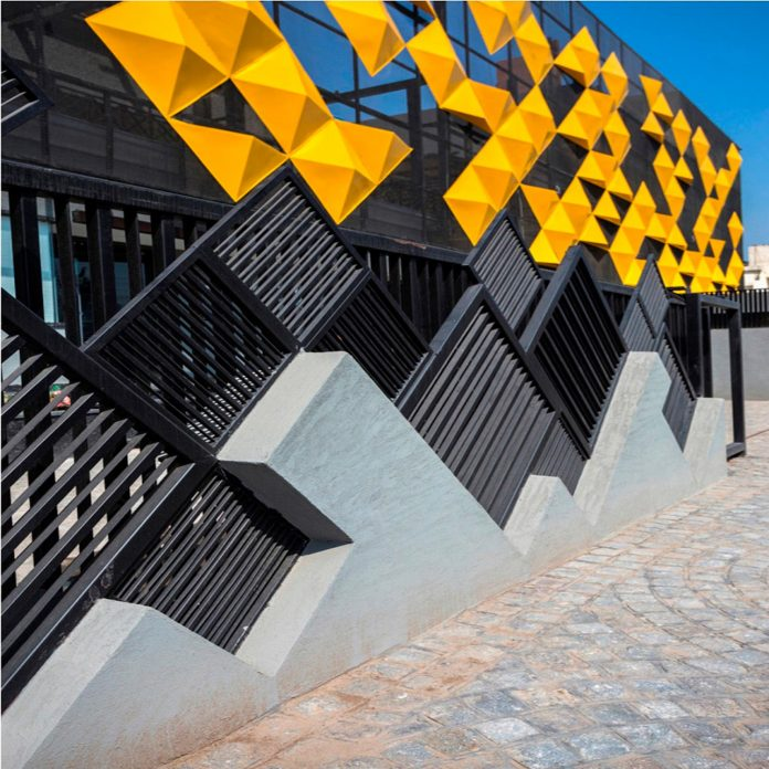 martins-dazzling-yellow-panels-facade-furniture-factory-designed-studio-ardete-10