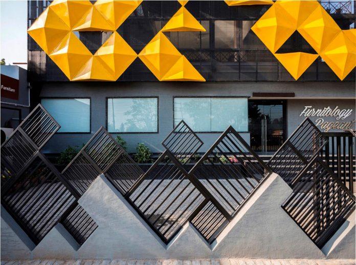 martins-dazzling-yellow-panels-facade-furniture-factory-designed-studio-ardete-11