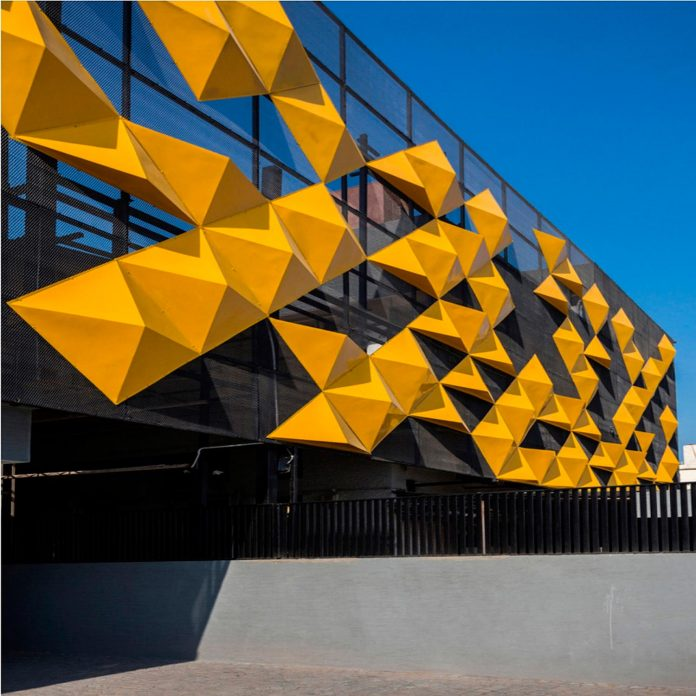 martins-dazzling-yellow-panels-facade-furniture-factory-designed-studio-ardete-13