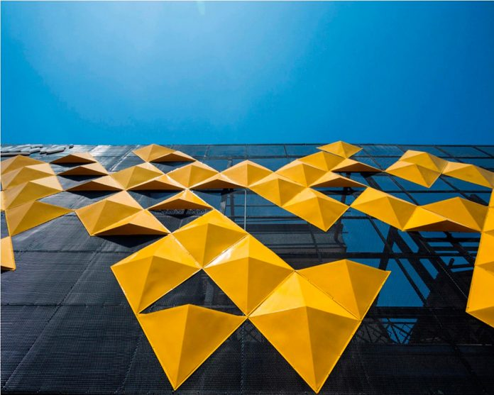 martins-dazzling-yellow-panels-facade-furniture-factory-designed-studio-ardete-14