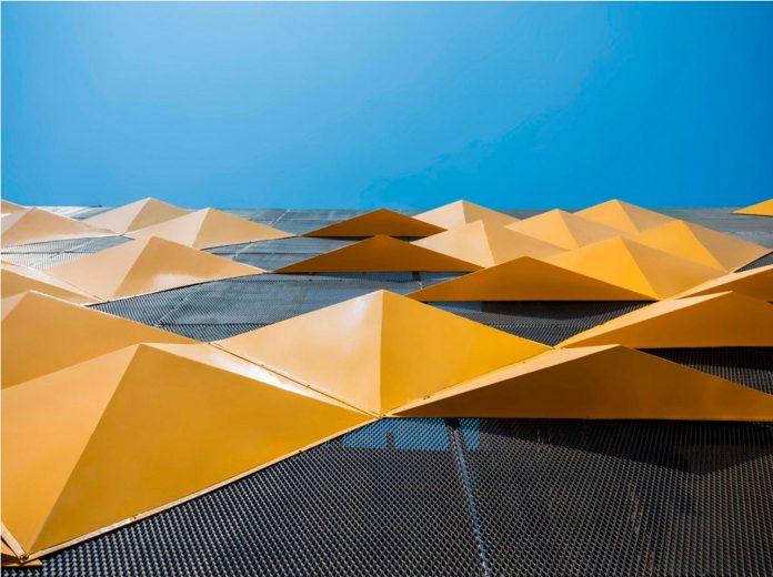 martins-dazzling-yellow-panels-facade-furniture-factory-designed-studio-ardete-15