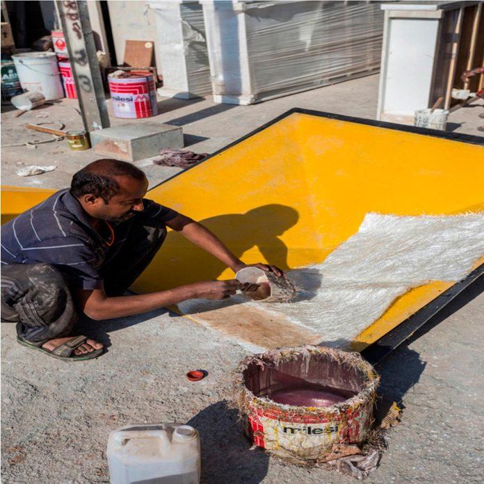 martins-dazzling-yellow-panels-facade-furniture-factory-designed-studio-ardete-16