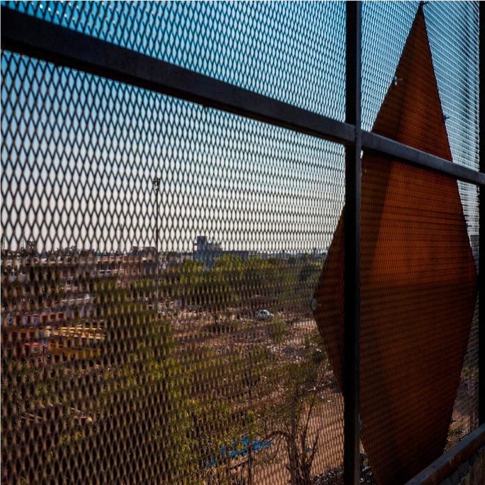martins-dazzling-yellow-panels-facade-furniture-factory-designed-studio-ardete-18