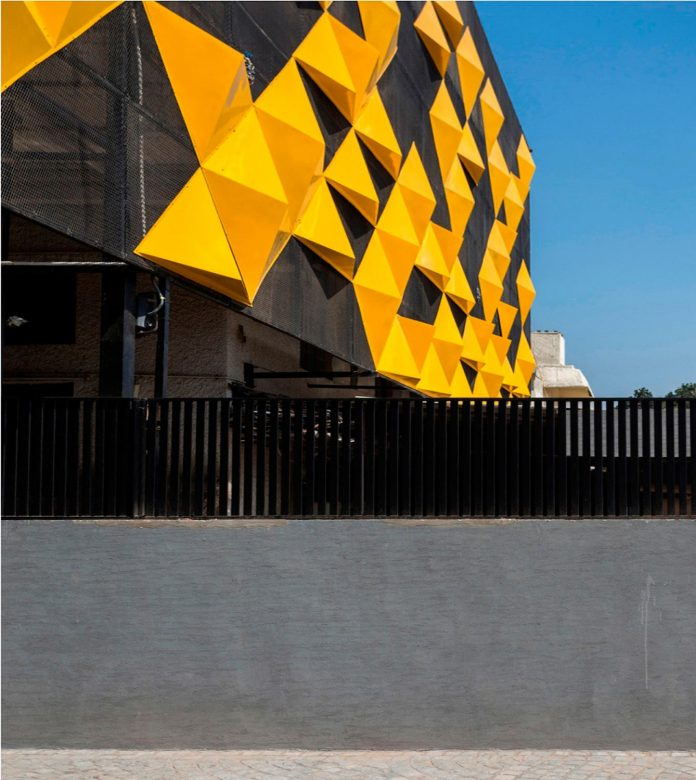 martins-dazzling-yellow-panels-facade-furniture-factory-designed-studio-ardete-19
