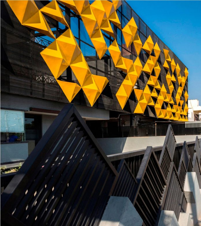 martins-dazzling-yellow-panels-facade-furniture-factory-designed-studio-ardete-20