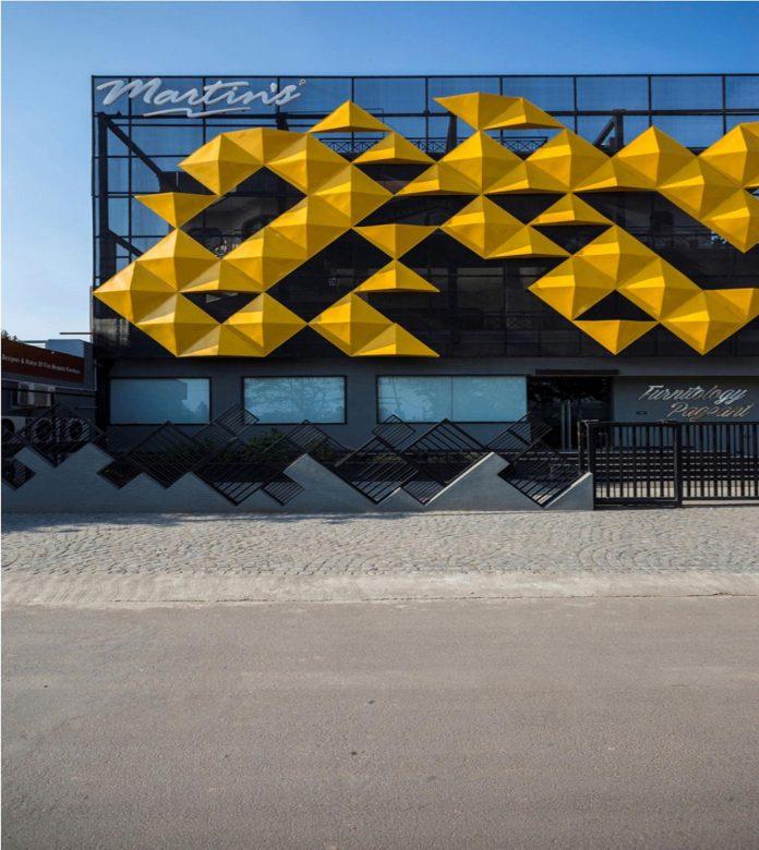 martins-dazzling-yellow-panels-facade-furniture-factory-designed-studio-ardete-21