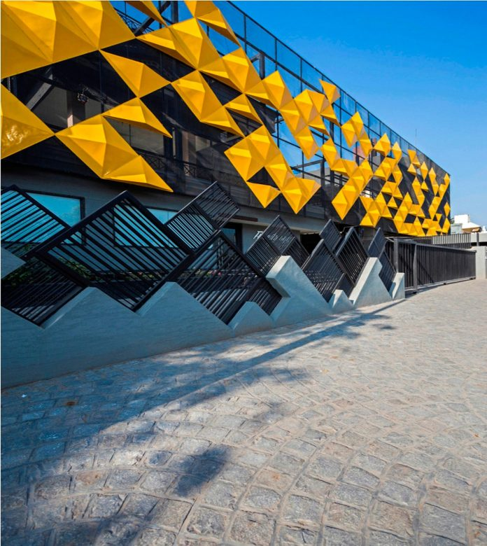 martins-dazzling-yellow-panels-facade-furniture-factory-designed-studio-ardete-22