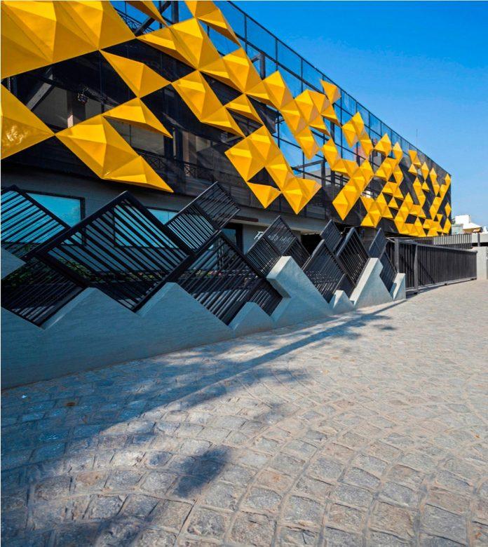 martins-dazzling-yellow-panels-facade-furniture-factory-designed-studio-ardete-22
