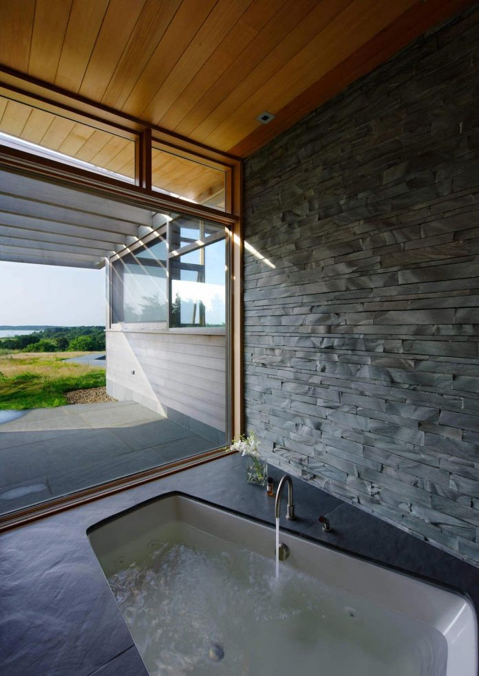 maryann-thompson-architects-design-bluff-house-occupying-crest-windblown-bluff-overlooking-atlantic-nearby-saltwater-ponds-11