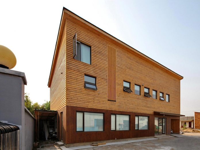 old-brick-single-story-house-converted-wooden-three-stories-home-slow-office-beijing-01
