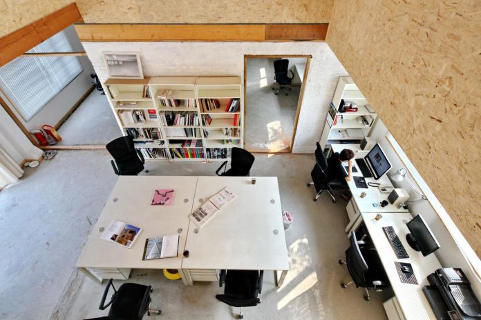 old-brick-single-story-house-converted-wooden-three-stories-home-slow-office-beijing-07