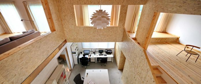 old-brick-single-story-house-converted-wooden-three-stories-home-slow-office-beijing-08