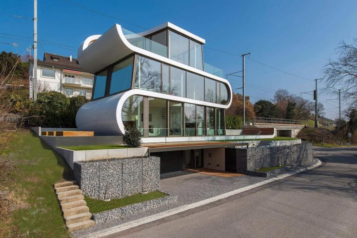 ultramodern-ribbon-winds-flexhouse-zurich-designed-evolution-design-02