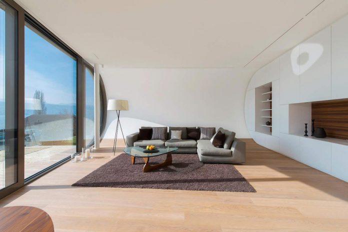 ultramodern-ribbon-winds-flexhouse-zurich-designed-evolution-design-10