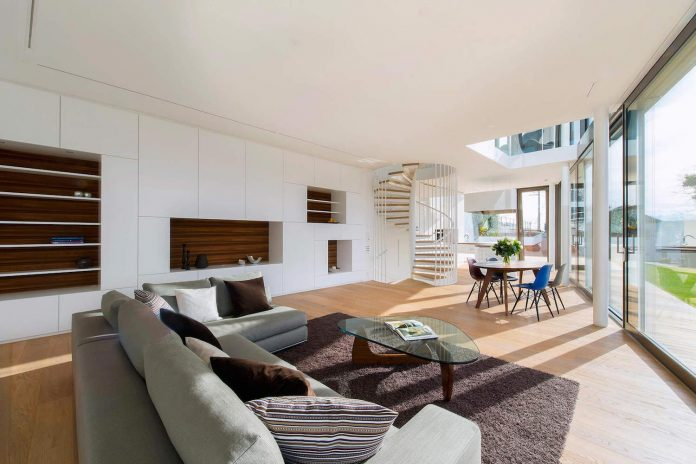 ultramodern-ribbon-winds-flexhouse-zurich-designed-evolution-design-11
