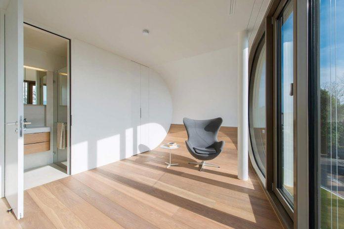 ultramodern-ribbon-winds-flexhouse-zurich-designed-evolution-design-18