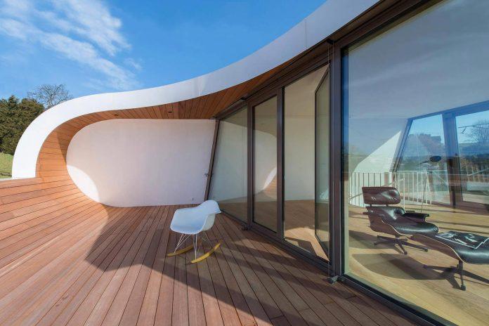 ultramodern-ribbon-winds-flexhouse-zurich-designed-evolution-design-23