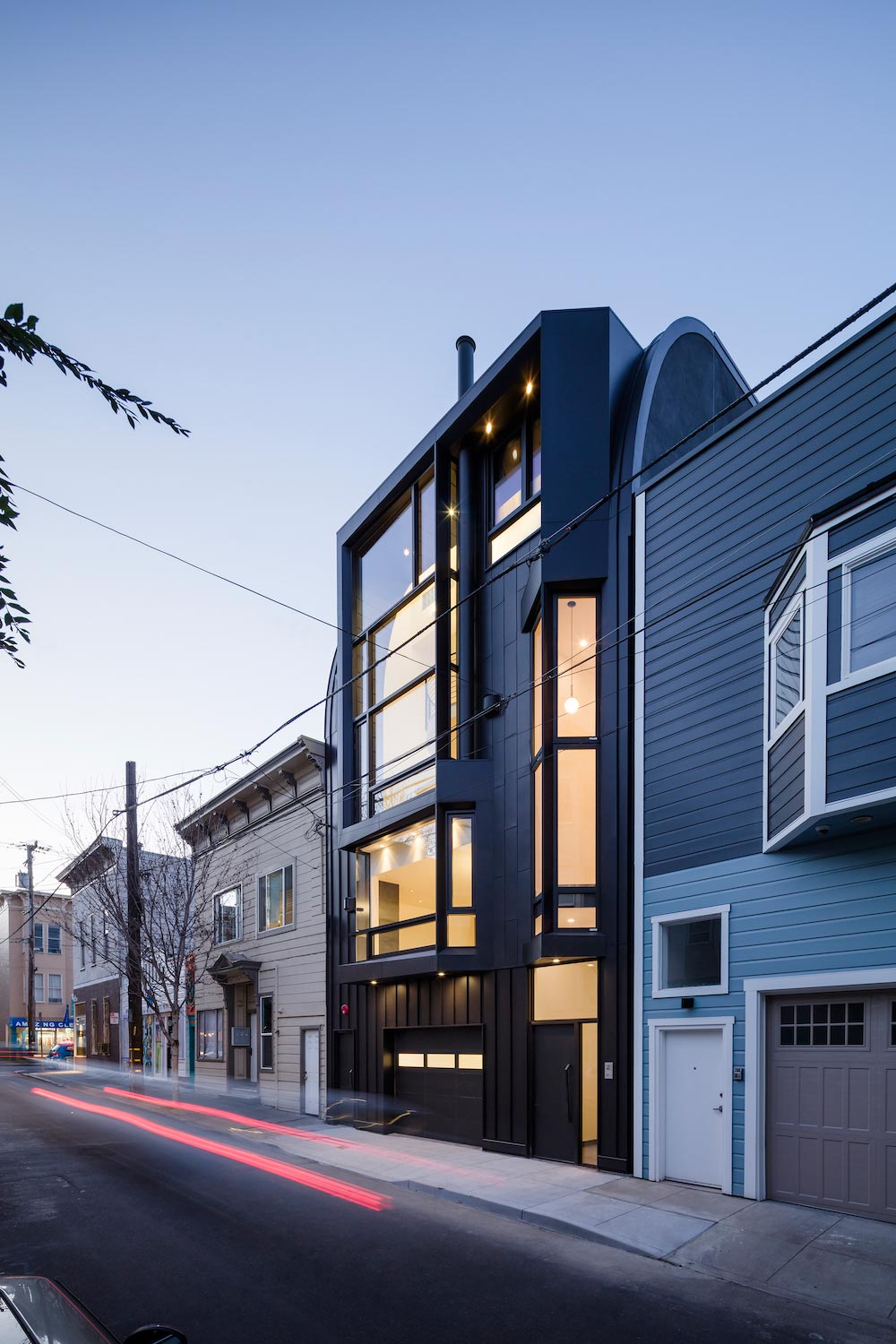 Black Mass apartment building designed by Stephen Phillips Architects plays with viewer perception to create dramatic visual and spatial effects