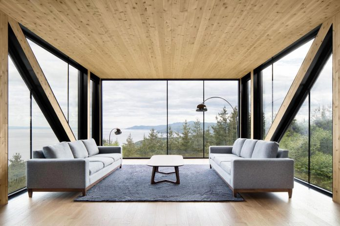 blanche-chalet-simple-pure-architecture-gently-complements-landscape-charlevoix-modern-fashion-10