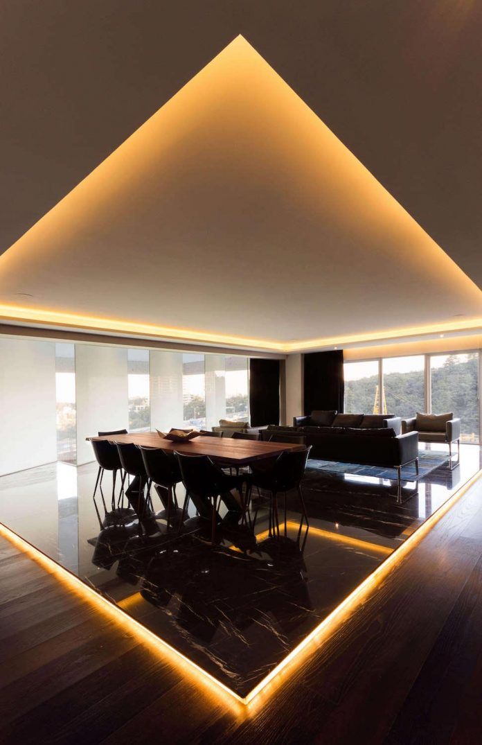 Contemporary apartment designed by Kababie Arquitectos in a ...