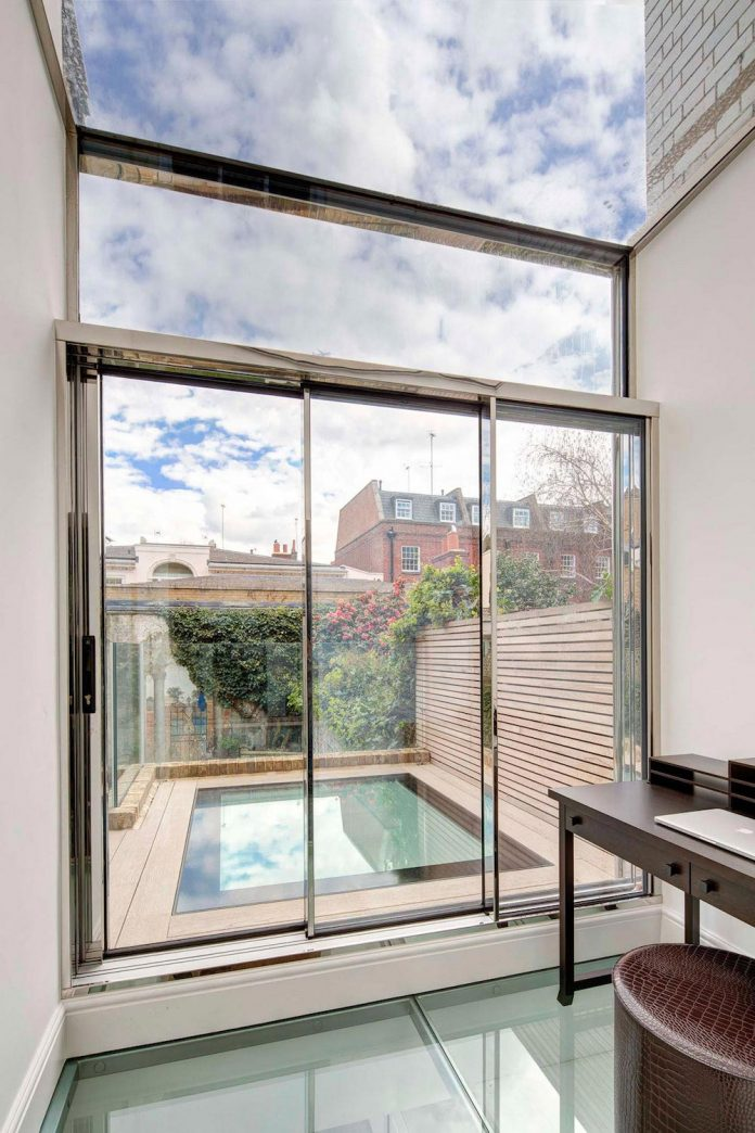 contemporary-glazed-extension-grade-ii-listed-house-provide-additional-space-without-detracting-original-building-07