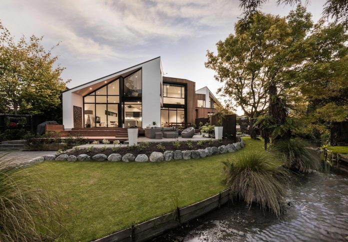 cymon-allfrey-architects-design-two-family-homes-make-beautiful-outlook-towards-wairarapa-stream-urban-christchurch-02