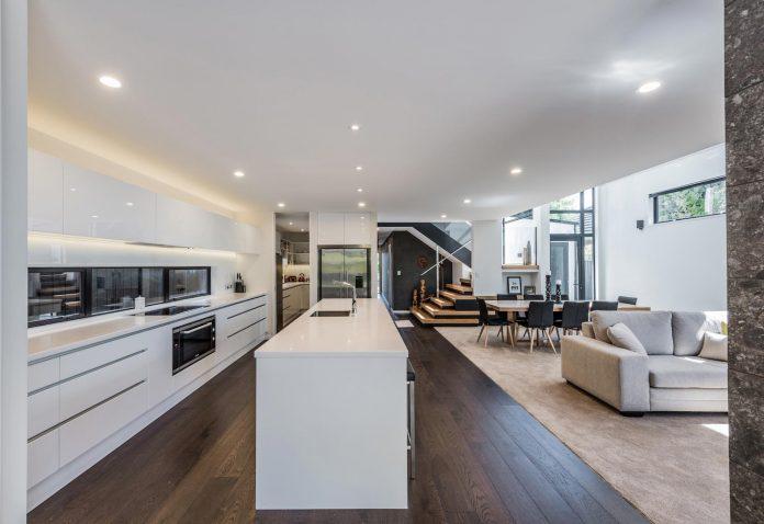 cymon-allfrey-architects-design-two-family-homes-make-beautiful-outlook-towards-wairarapa-stream-urban-christchurch-08