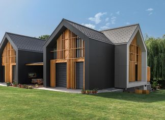 Family Villa XL designed for a large family of seven formed from two mutually parallel volumes and one connecting volume