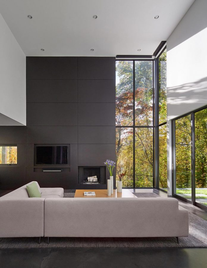 Linear Composition Of A Minimal Home With Two Story Living Space And