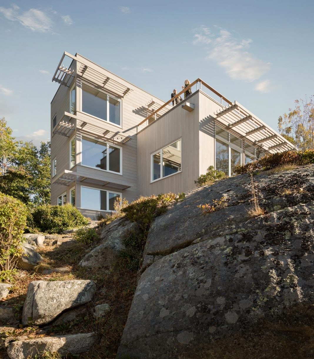 Located on the a granite knob 30' above a lily pond the house overlooks the Atlantic Ocean to the south