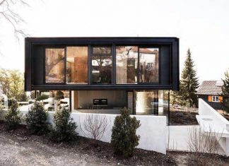 Modern house in Riehen made by glass, concrete, wood, and metal serve, designed by Reuter Raeber Architects