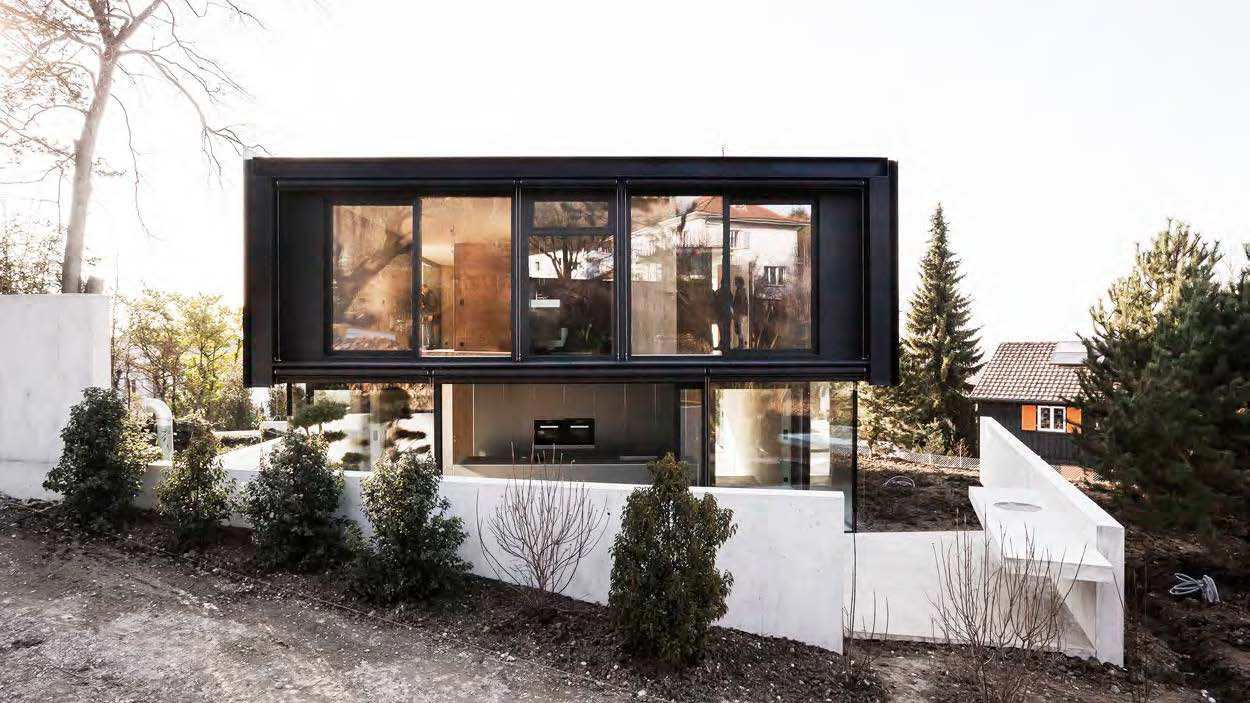 Modern house in riehen made by glass concrete wood and for Modern home blog