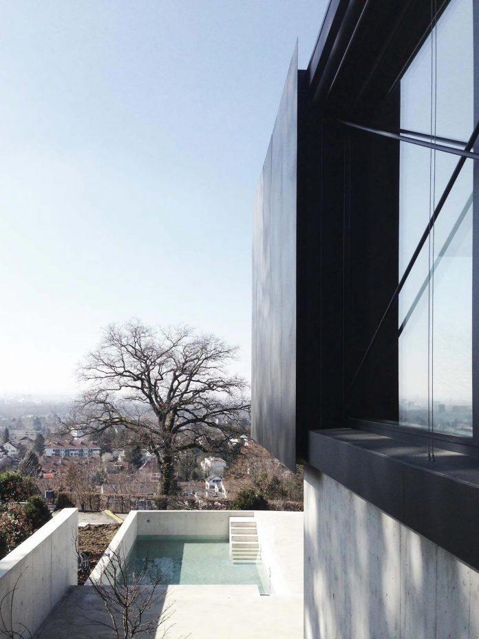 modern-house-riehen-made-glass-concrete-wood-metal-serve-designed-reuter-raeber-architects-03