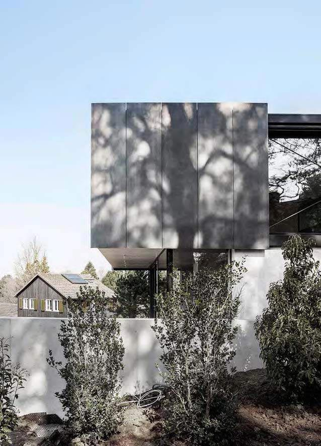 modern-house-riehen-made-glass-concrete-wood-metal-serve-designed-reuter-raeber-architects-04