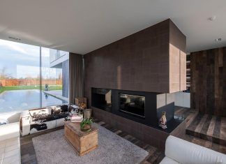 P8 Architecten design the LNT House, a contemporary two story home with indoor and outdoor pools