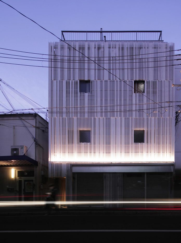 renovation-39-year-old-structure-contemporary-building-facade-white-fins-conceal-two-stores-01