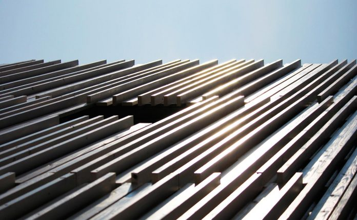 renovation-39-year-old-structure-contemporary-building-facade-white-fins-conceal-two-stores-02
