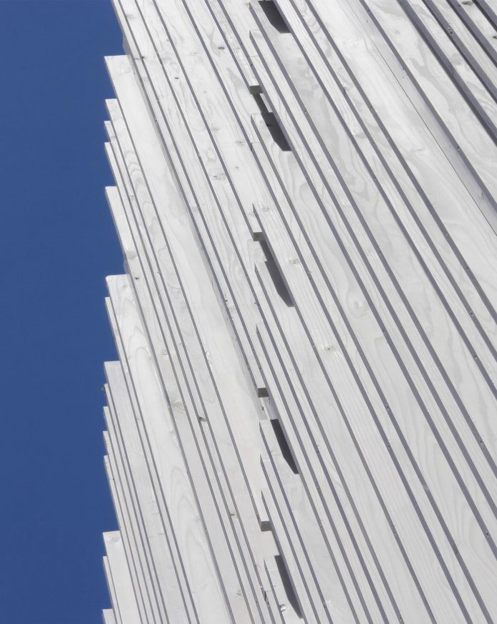 renovation-39-year-old-structure-contemporary-building-facade-white-fins-conceal-two-stores-05