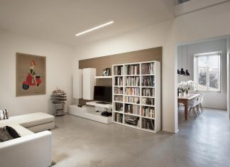 Renovation of an apartment located inside a former school of music in a XIX century building in the historic center of Siena