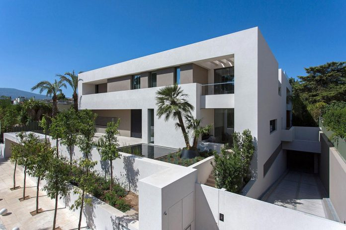 small-exotic-paradise-l-shaped-form-modern-home-athens-designed-moustroufis-architects-01