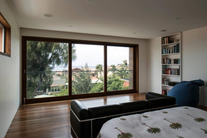 timber-box-home-sits-top-glass-box-renovation-sydney-10